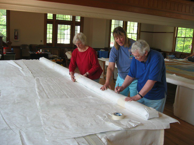 Chris Hadsel, Dir of Painted Theater Curtains and Vols wrapping and labeling for storage