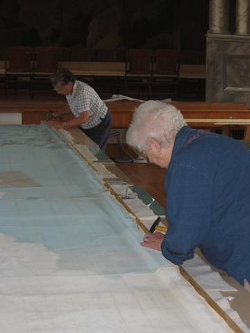 Vols Marge Holt & Ginny Chamberlin prepping lower edge w wooden slats
