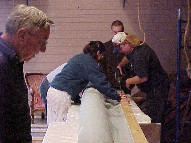 Volunteers Prepare to Install Curtain